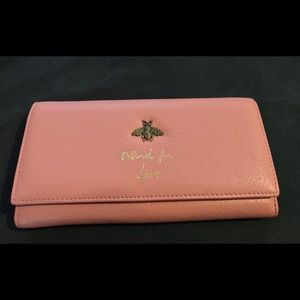 Women's Gucci continental blind for love wallet.